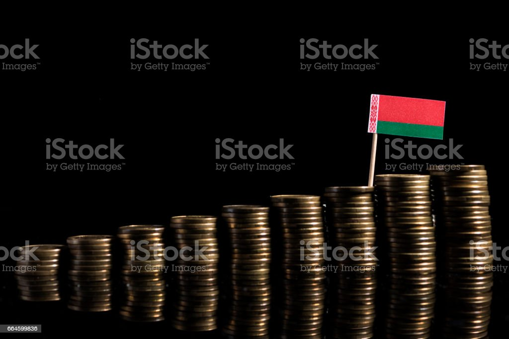 Belarus flag with lot of coins isolated on black background stock photo
