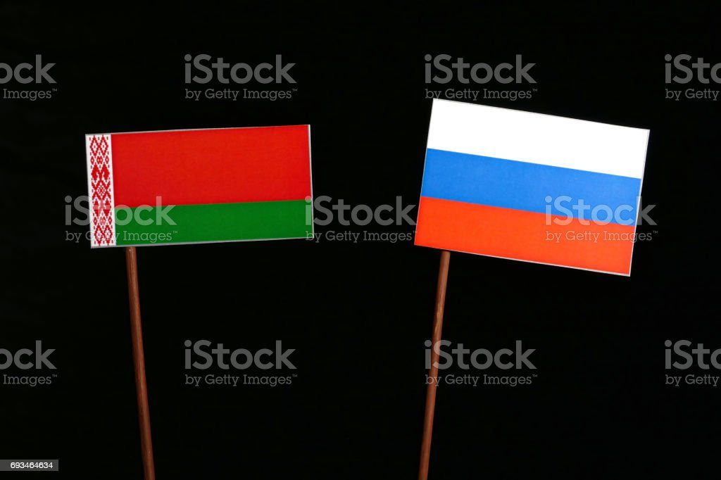 Belarus flag with Russian flag isolated on black background stock photo
