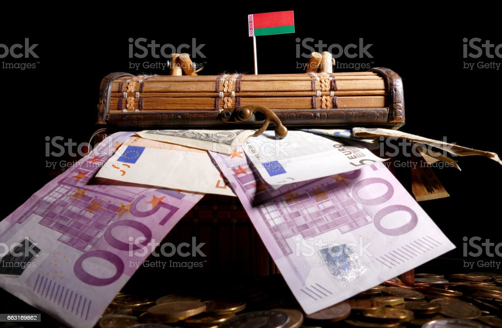 Belarusian flag on top of crate full of money stock photo