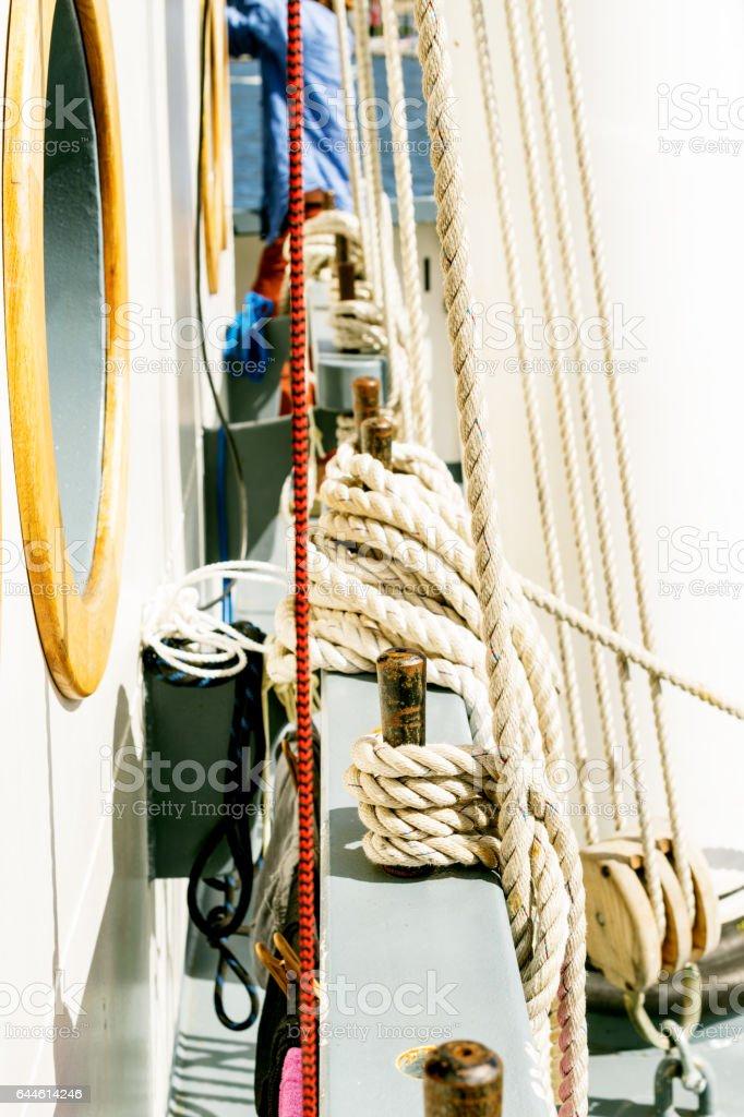 Belayingl pins and window or porthole on a tall ship stock photo