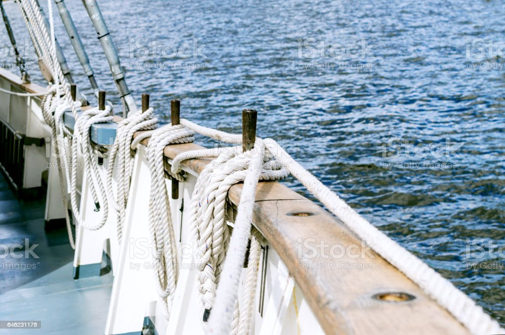 Belayingl pins on a tall ship stock photo