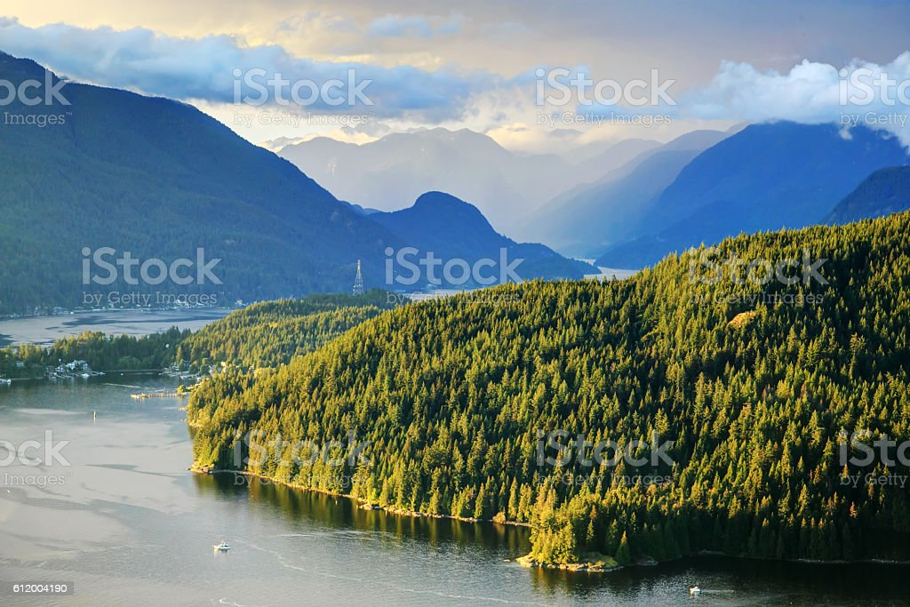 Belcarra Park and Burrard Inlet, with cloudscape at sunset time stock photo