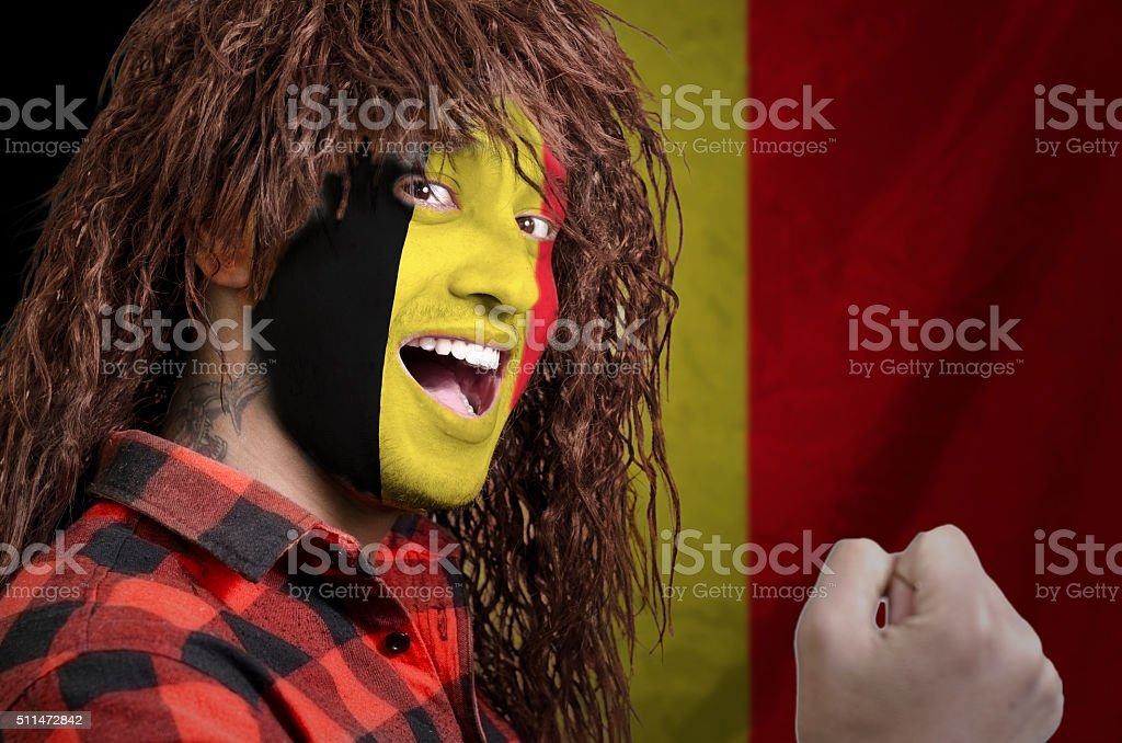 Belgian fan with face painted stock photo