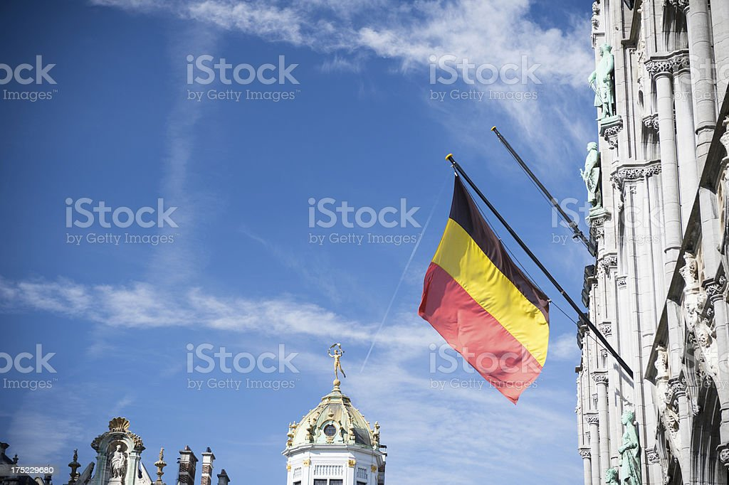 Belgian flag fluttering at the Grand Place in Brussels stock photo