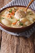 Belgian hot cream soup with chicken waterzooi closeup