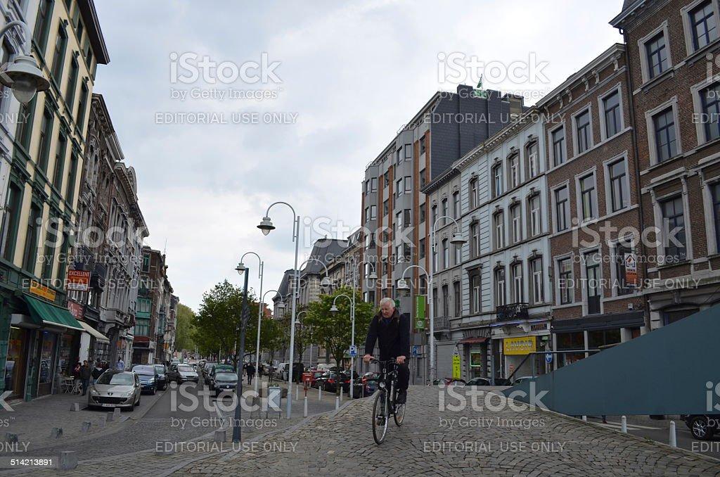 Belgian man in descending from the bridge in Liege. stock photo