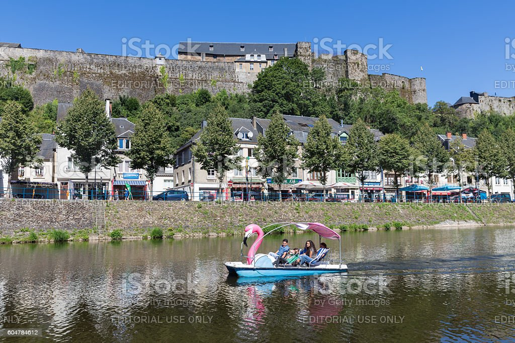 Belgian medieval city with people in pedalo at river Semois stock photo