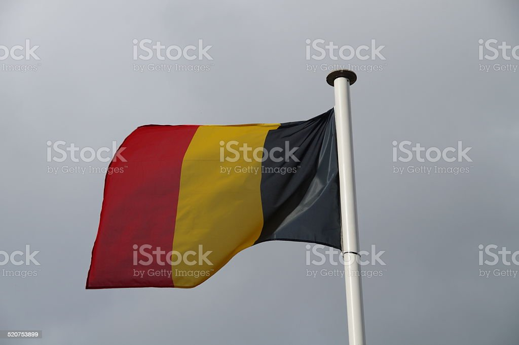 Belgian national flag blowing in the wind stock photo