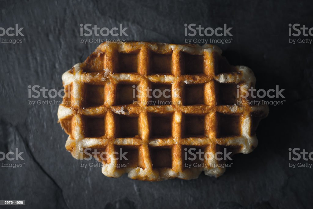 Belgian waffle on the dark stone background top view stock photo