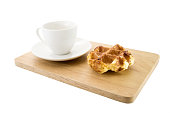 Belgian waffle with cup of coffee on the wooden table