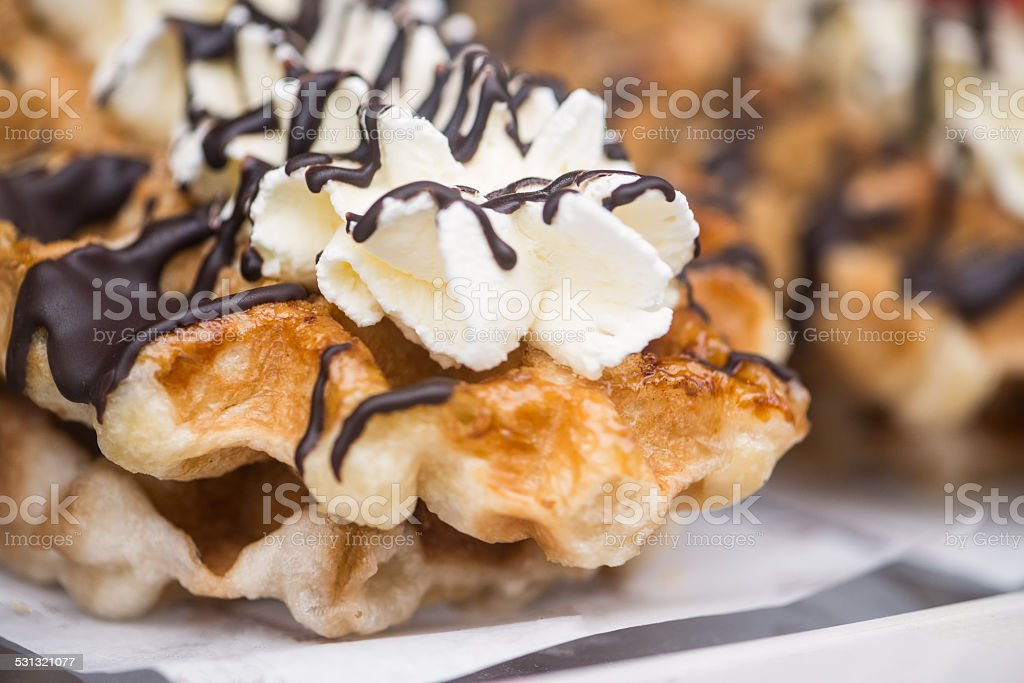 Belgian Waffles Topped with Whipped Cream and Chocolate Sauce stock photo