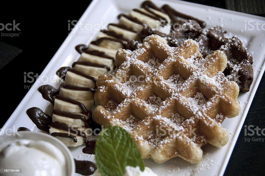 Belgian Waffles with bananas, chocolate, and cream stock photo