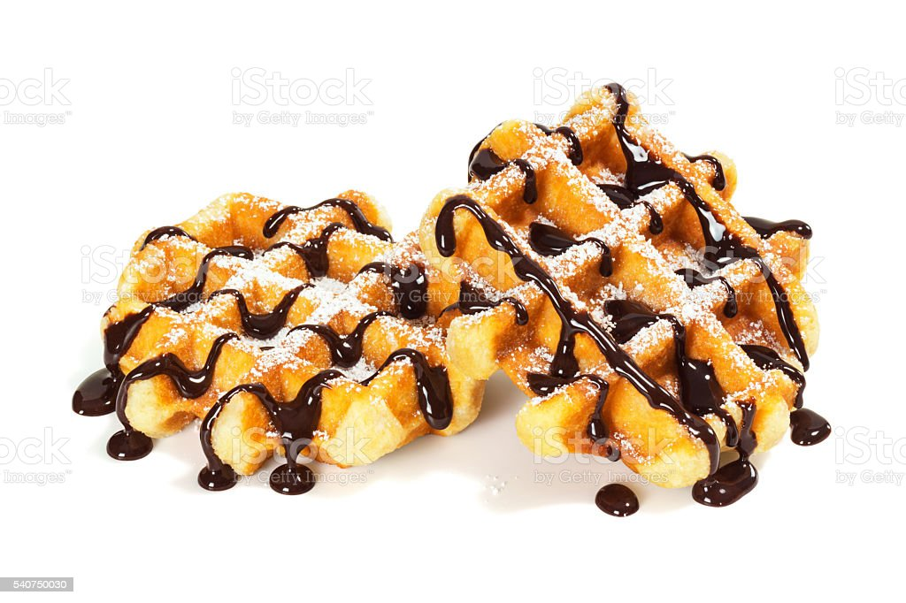 Belgian (Liege) Waffles with Chocolate Sauce and Powdered Sugar stock photo