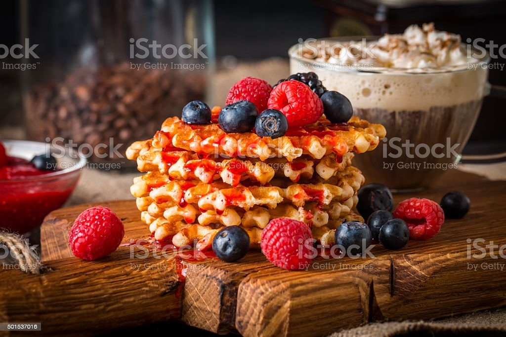 Belgian waffles with fresh berries and coffee stock photo