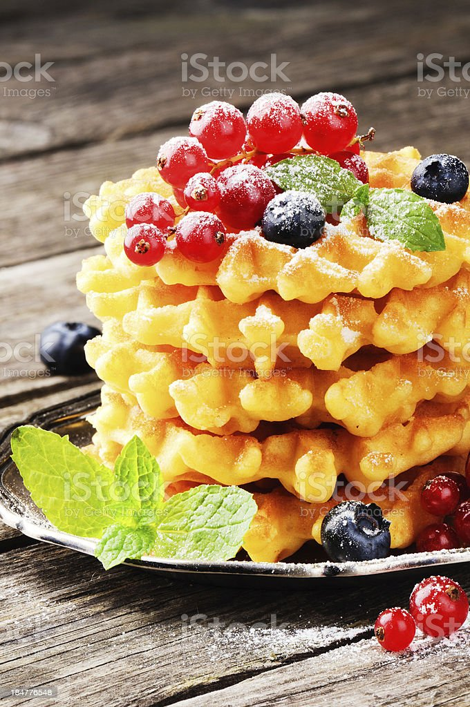 Belgian waffles with fresh berries royalty-free stock photo