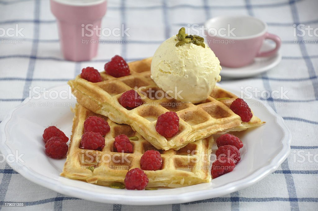 Belgian waffles with ice cream and berries royalty-free stock photo