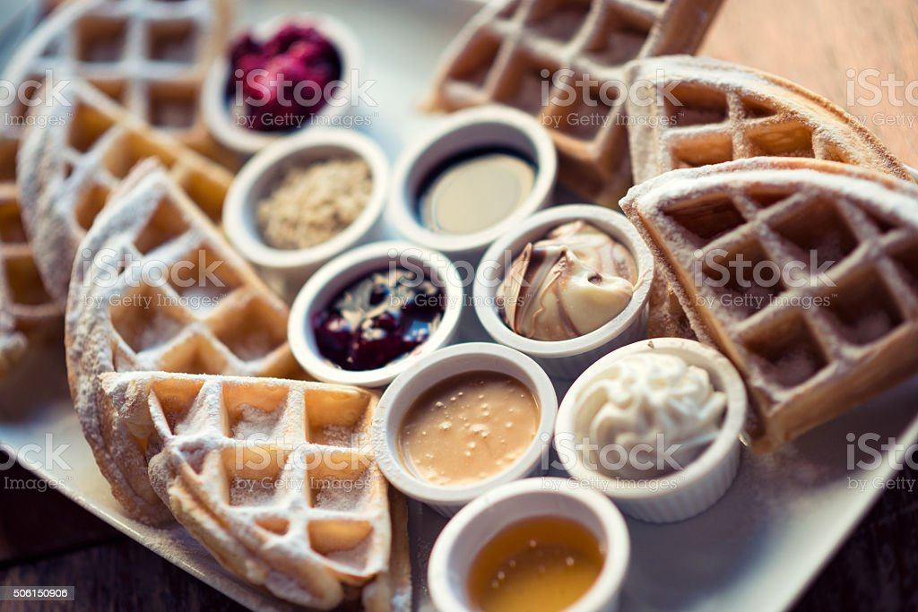Belgian Waffles With many Flavors, Fruit and Maple Syrup stock photo