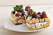 Belgian waffles with raspberries and blueberries