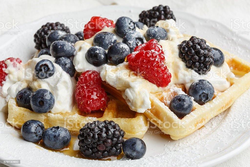 Belgian waffles with whipped cream stock photo