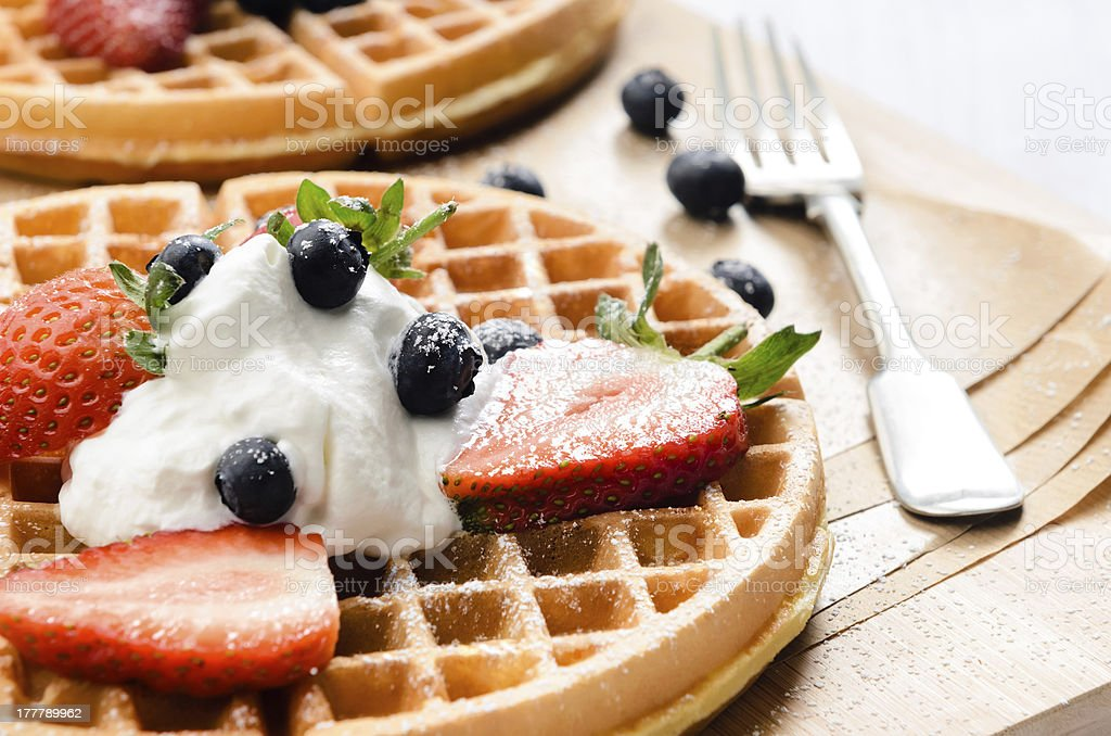 Belgian waffles with yoghurt and fruit stock photo