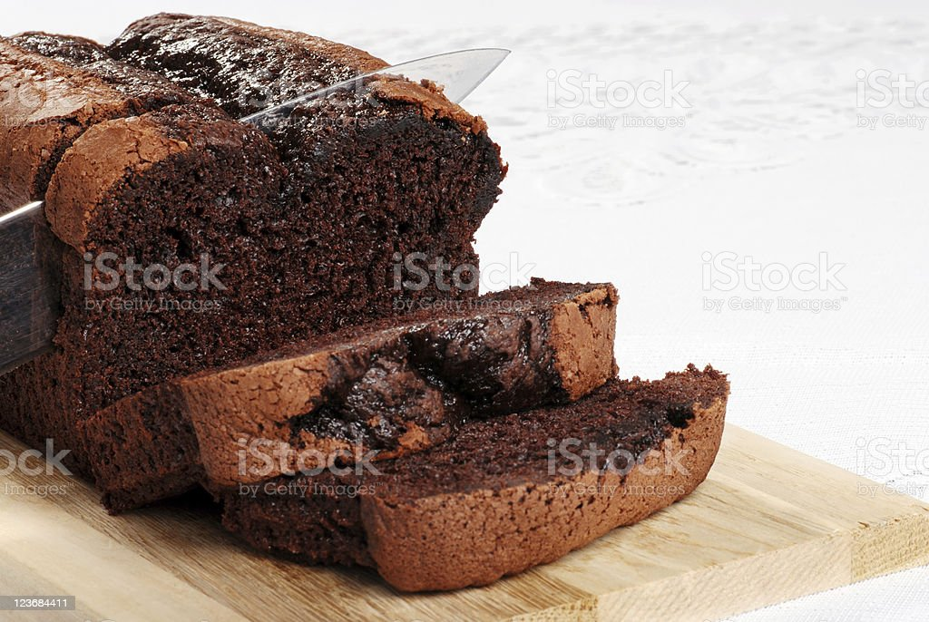 Belgium chocolate cake being sliced with knife royalty-free stock photo