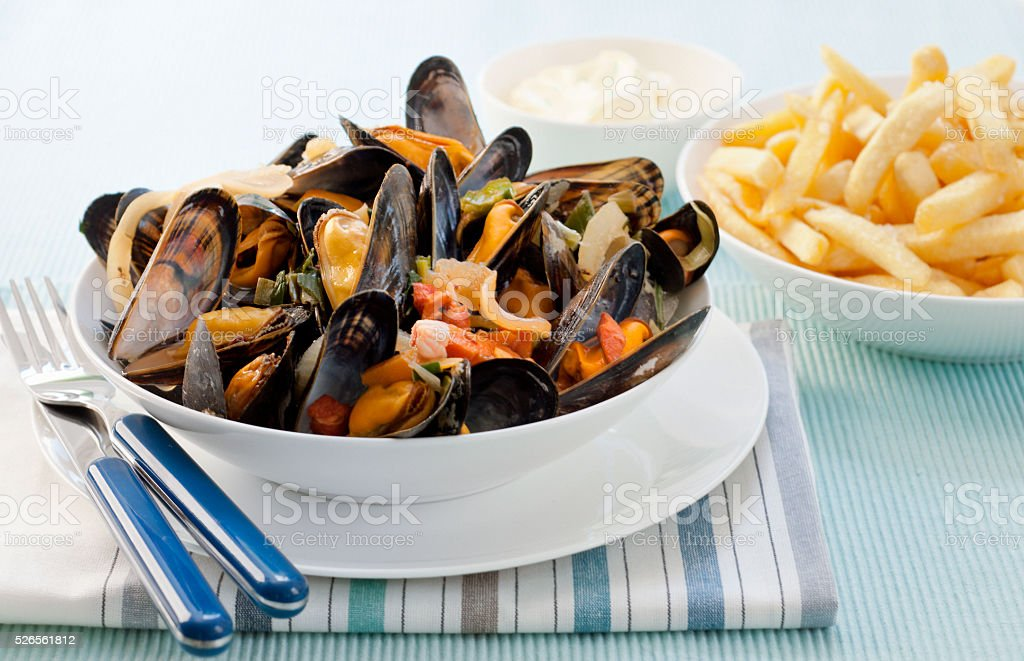Belgium mussel with french fries in a bowl stock photo