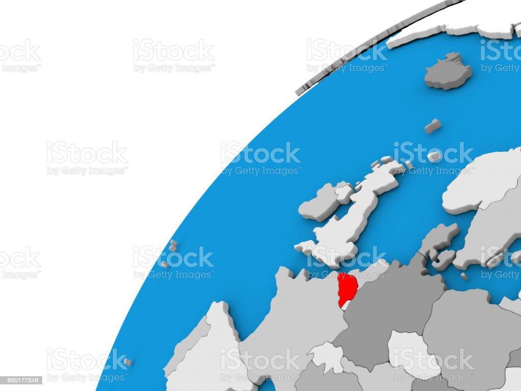 Belgium on globe in red stock photo