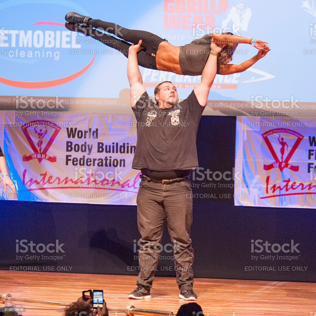 Belgium strongman Jimmy Laureys lifts girls on stage stock photo