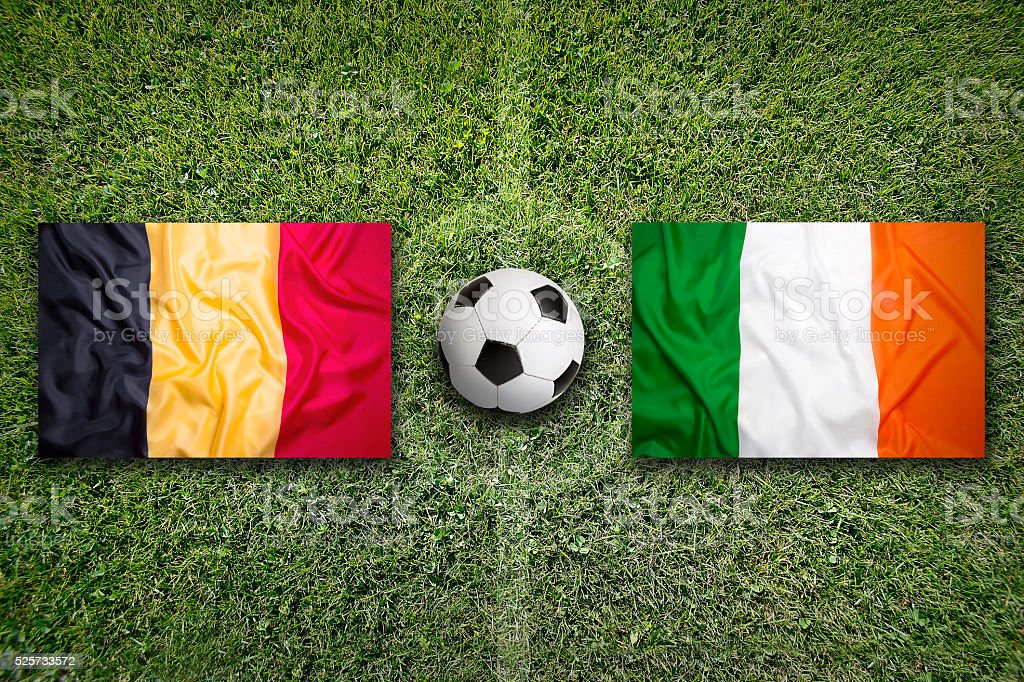 Belgium vs. Ireland flags on soccer field stock photo