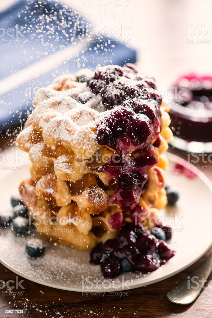 Belgium Waffles Stack, Blueberry Compote, Fresh Blueberries and Icing Sugar stock photo