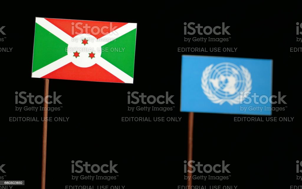 Belgrade, Serbia. May 5th 2017: Burundi flag with United Nations flag isolated on black background stock photo