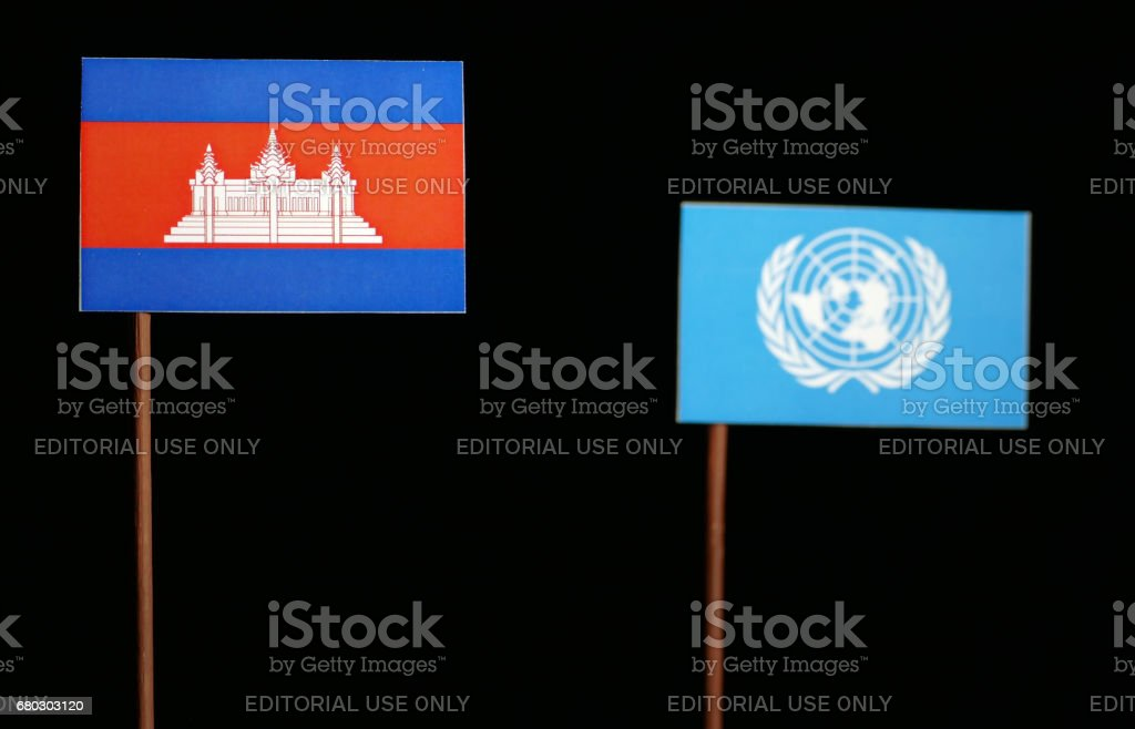 Belgrade, Serbia. May 5th 2017: Cambodian flag with United Nations flag isolated on black background stock photo