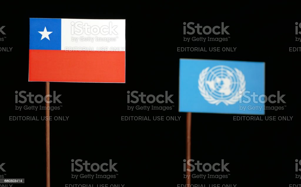 Belgrade, Serbia. May 5th 2017: Chilean flag with United Nations flag isolated on black background stock photo