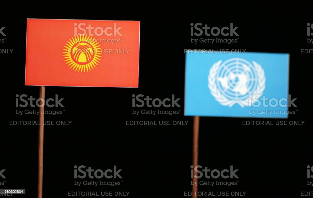 Belgrade, Serbia. May 5th 2017: Kyrgyzstani flag with United Nations flag isolated on black background stock photo