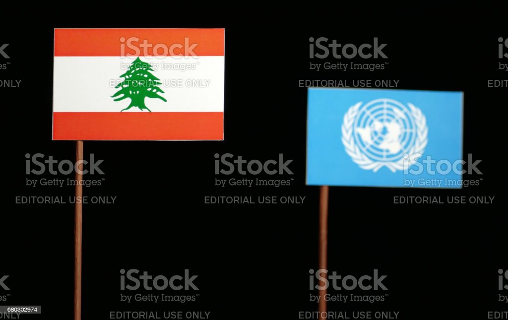 Belgrade, Serbia. May 5th 2017: Lebanese flag with United Nations flag isolated on black background stock photo