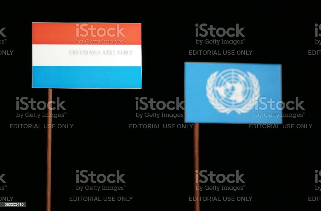 Belgrade, Serbia. May 5th 2017: Luxembourg flag with United Nations flag isolated on black background stock photo