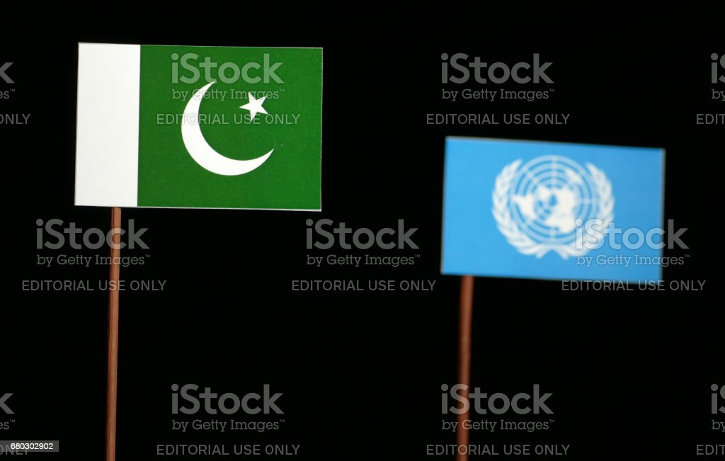 Belgrade, Serbia. May 5th 2017: Pakistani flag with United Nations flag isolated on black background stock photo
