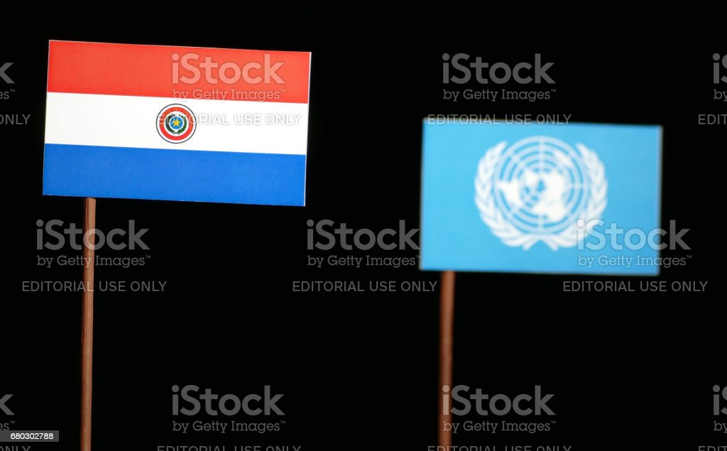Belgrade, Serbia. May 5th 2017: Paraguayan flag with United Nations flag isolated on black background stock photo