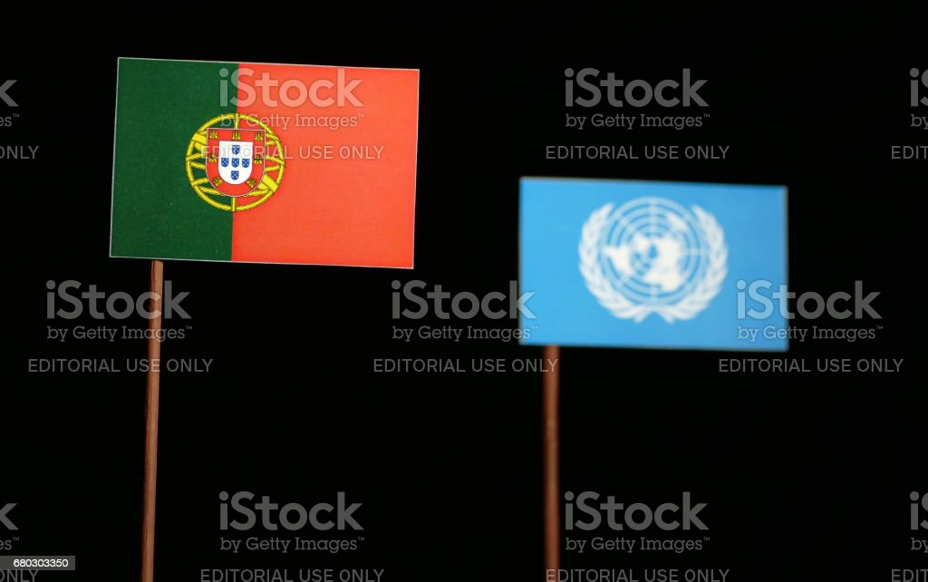 Belgrade, Serbia. May 5th 2017: Portuguese flag with United Nations flag isolated on black background stock photo
