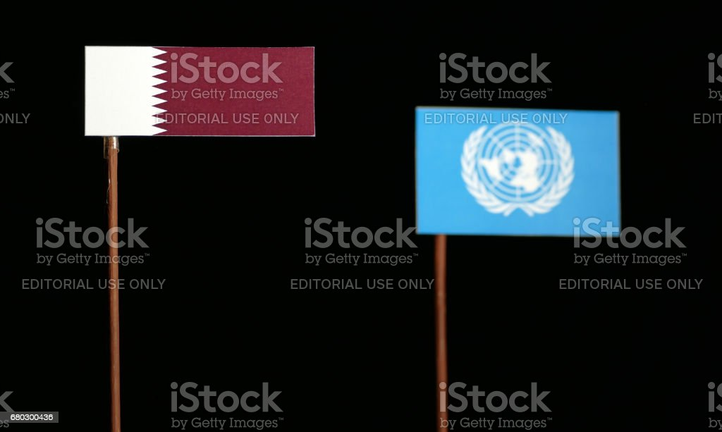 Belgrade, Serbia. May 5th 2017: Qatari flag with United Nations flag isolated on black background stock photo