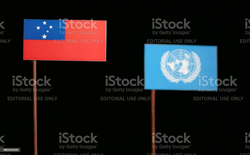 Belgrade, Serbia. May 5th 2017: Samoa flag with United Nations flag isolated on black background stock photo