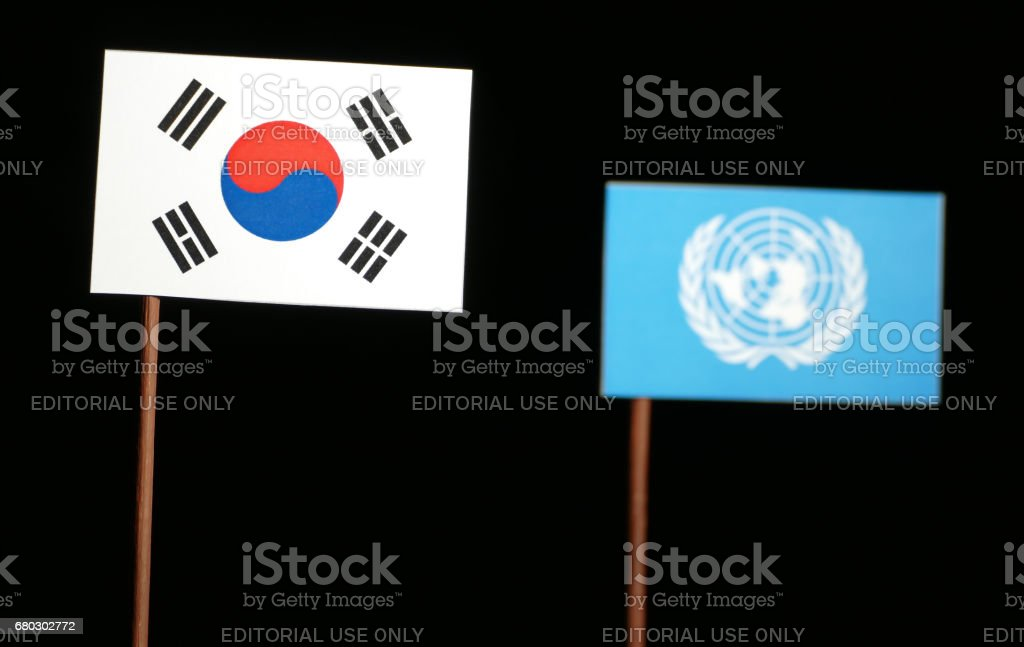 Belgrade, Serbia. May 5th 2017: South Korean flag with United Nations flag isolated on black background stock photo