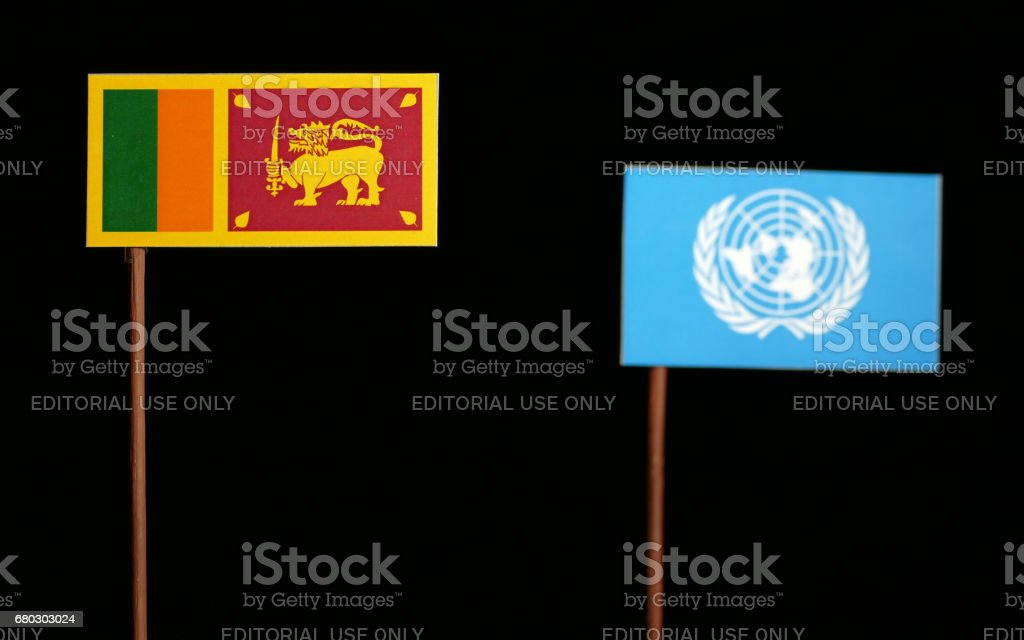 Belgrade, Serbia. May 5th 2017: Sri Lankan flag with United Nations flag isolated on black background stock photo