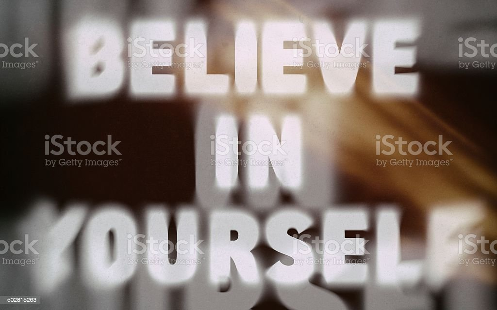 Believe in yourself word on blurred background royalty-free stock photo
