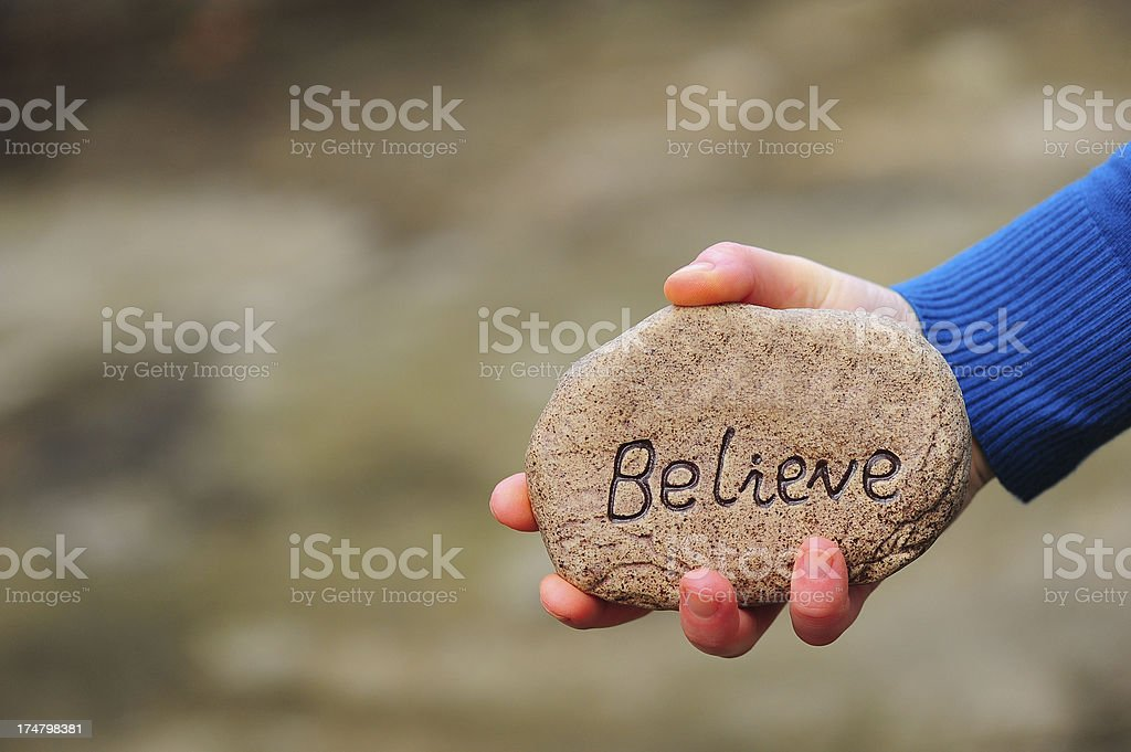 Believe on stone royalty-free stock photo
