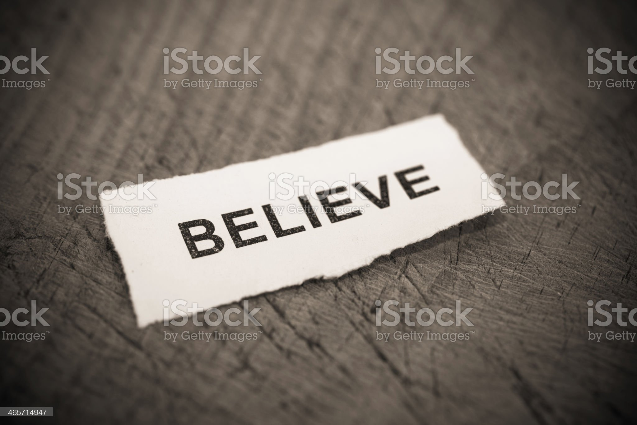 'Believe' text on wood background royalty-free stock photo