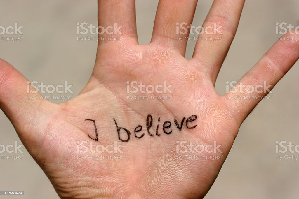I believe written on the palm of a hand in black ink stock photo