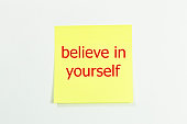 belive in yourself word written on yellow sticky notes