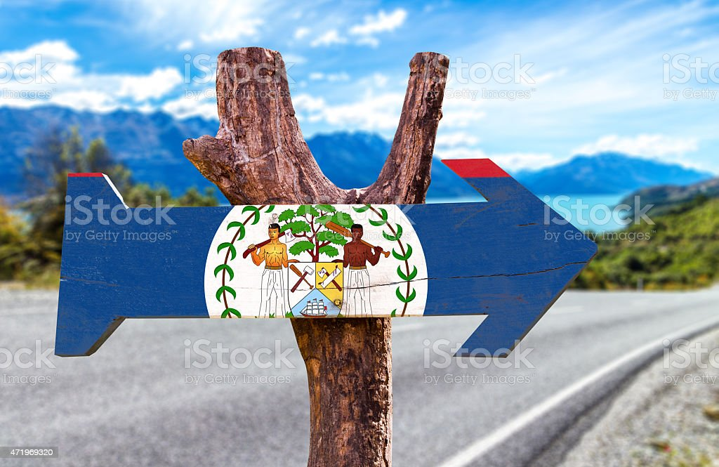 Belize Flag wooden sign with road background stock photo
