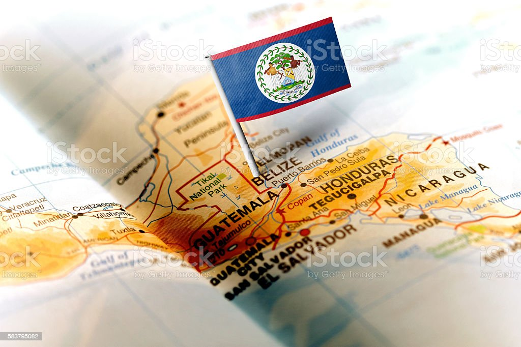 Belize pinned on the map with flag stock photo